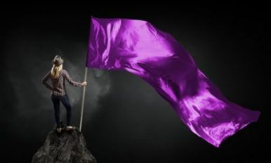 Student girl in casual with purple flag in hands